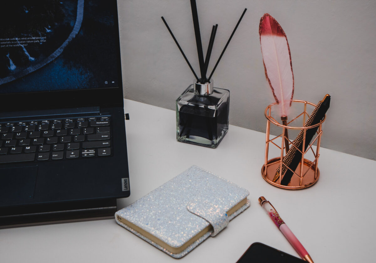 Cover image of a desk with writing equipment